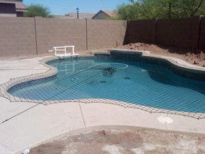 Large pool net covering a backyard pool